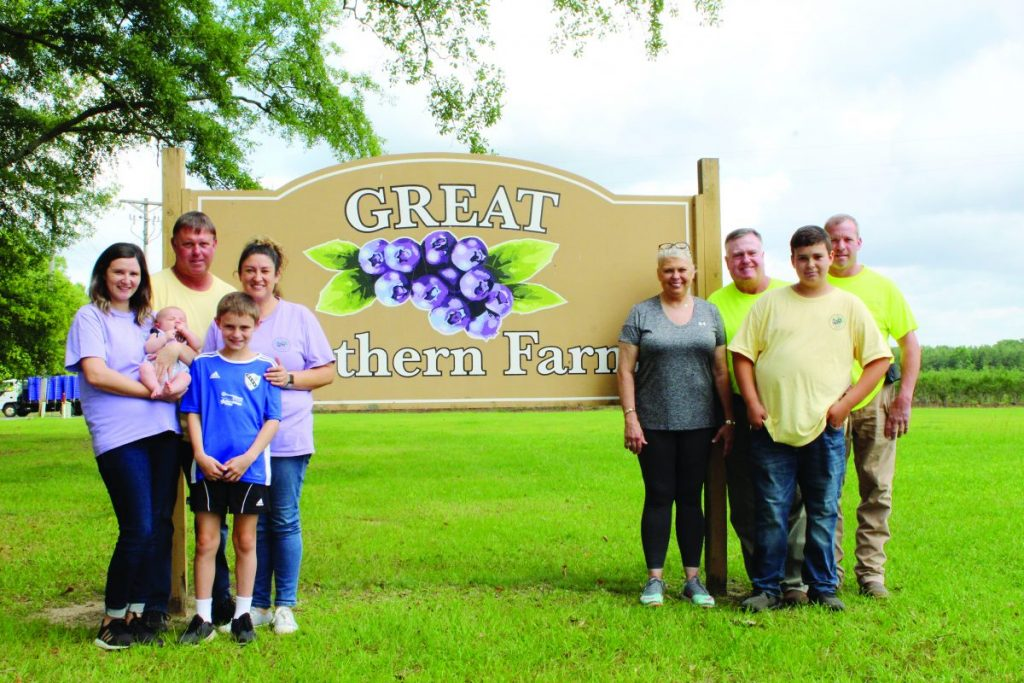 Malcolm Edwards and wife Evia are proud to have a family legacy to pass along to their children and grandchildren. So far, four generations of Edwards (shown here) have made their mark on the farm, and the family is hopeful there will be many more to come.  Photo by Annette Harvison - Dispatch Staff